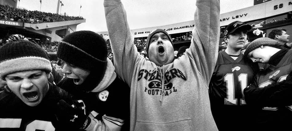 Fans from both teams react to a James Harrison fumble returned for a touchdown. Ralph Wilson Stadium, Buffalo, NY 2005.